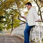 Man checking his cell phone in park: SEOMedical Medical Online Marketing Blog