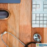 stethoscope lying on desk next to keyboard to suggest medical seo
