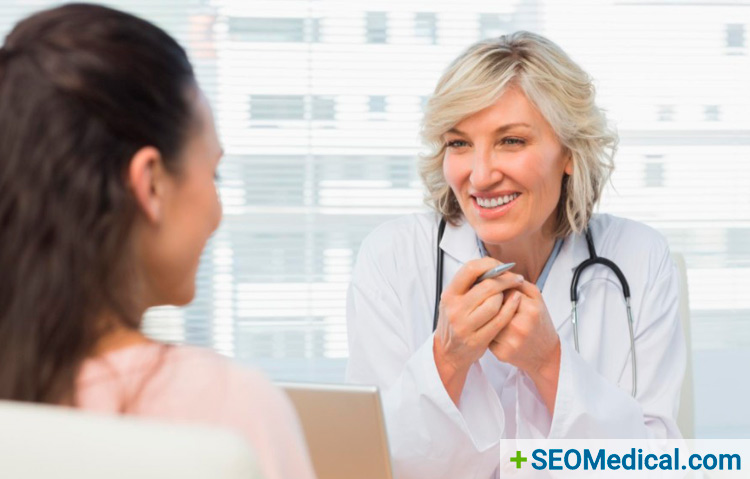 Friendly doctor speaking openly with her patient